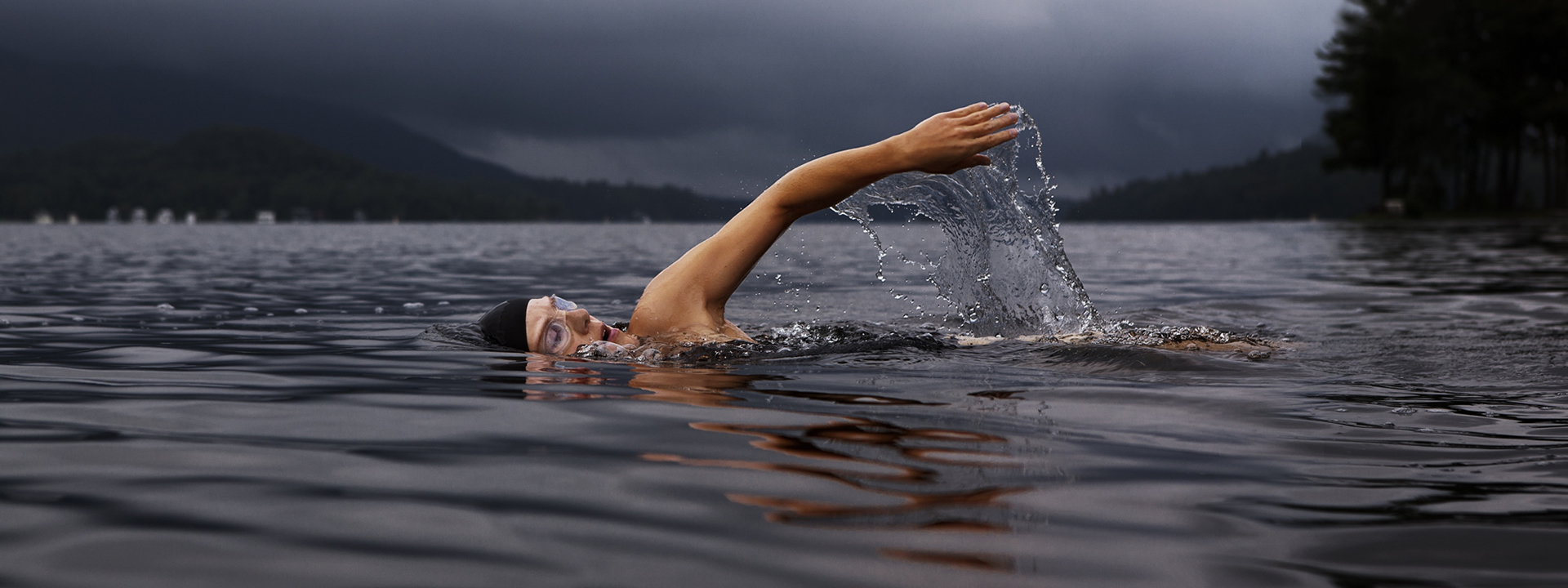swimmer in lake water